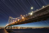 California, San Francisco. Composite of Star Trails Above Bay Bridge Photographic Print by Jaynes Gallery