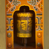 Bhutan. Prayer Wheel Spins in the Wall of a Temple Photographic Print by Brenda Tharp