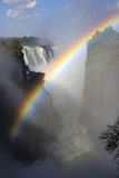 Africa, Zimbabwe, Victoria Falls. Rainbow over Falls Photographic Print by Jaynes Gallery