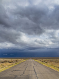 Nevada. Road into Approaching Storm Photographic Print by Jaynes Gallery
