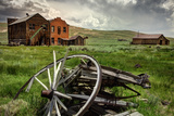 California, Bodie State Historic Park. Broken Wagon and Abandoned Buildings Photographic Print by Jaynes Gallery