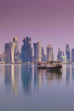 Qatar, Doha, Dhows on Doha Bay with West Bay Skyscrapers, Dawn Photographic Print by Walter Bibikow