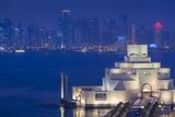 Qatar, Doha, Cityscape at Dusk Photographic Print by Walter Bibikow