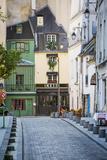Couple Stroll Down Rue Saint-Julien Le Pauvre in the Latin Quarter, Paris France Photographic Print by Brian Jannsen