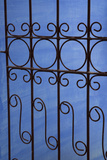 Cuba, Vinales, Wrought Iron Gate and Blue Wall Photographic Print by John and Lisa Merrill