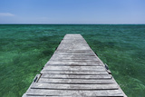 A Wood Dock in the Foreground with Clear Green Water and Blue Skies Near the Isle of Youth, Cuba Photographic Print by James White