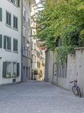 Switzerland, Zurich, Historic Lindenhof Area, Schussel Gasse, a Cobblestone Side Street Photographic Print by Jamie And Judy Wild