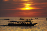 Sunset over Boats on Tonle Sap Lake at Chong Kneas Floating Village, Near Siem Reap, Cambodia Photographic Print by David Wall
