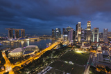 Singapore, City Skyline Elevated View Above the Padang, Dusk Photographic Print by Walter Bibikow
