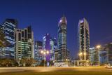 Qatar, Doha, Doha Bay, West Bay Skyscrapers, Dusk Photographic Print by Walter Bibikow