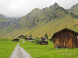 Switzerland, Bern Canton, Murren, Chalets and Barns in Alpine Environment Photographic Print by Jamie And Judy Wild