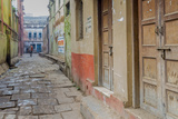 India, Varanasi a Man Walking Down a Stone Tiled Street in the Downtown Area Photographic Print by Ellen Clark
