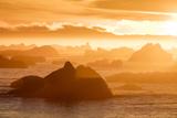Norway, Svalbard, Nordaustlandet. Silhouette of Icebergs Backlit at Sunset Photographic Print by Jaynes Gallery