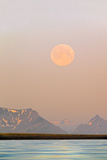 Arctic, Svalbard, Longsfjorden. Moonrise Rises Through Dust at Midnight Photographic Print by David Slater