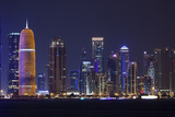 Qatar, Doha, Doha Bay, West Bay Skyscrapers, Dusk, with Burj Qatar Tower Photographic Print by Walter Bibikow