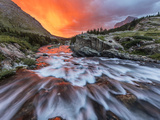 Brilliant Sunrise Sky over Swiftcurrent Falls in Glacier National Park, Montana, Usa Photographic Print by Chuck Haney