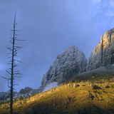 Sunset over Garden Wall with Snow, Glacier National Park, Montana, Usa Photographic Print by Tim Fitzharris