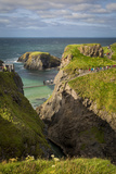 Tourists Walk across Carrick-A-Rede Rope Bridge Along North Coast, County Antrim, Northern Ireland Photographic Print by Brian Jannsen