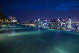 Singapore, Rooftop Swimming Pool at Dusk Overlooks the City Photographic Print by Walter Bibikow