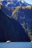 A Cruise Ship on the Waters of Milford Sound in the South Island of New Zealand Photographic Print by Paul Dymond