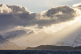 South Georgia Island, Bay of Isles. Storm Clouds over Mountains at Sunset Photographic Print by Jaynes Gallery