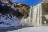 Skogafoss in Winter with Rainbow in Skoga, Iceland Photographic Print by Chuck Haney