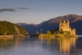 Setting Sunlight on Eilean Donan Castle Along Loch , Dornie, Highlands, Scotland Photographic Print by Brian Jannsen