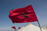 Africa, Western Sahara, Dakhla. the Flag of Morocco Blowing in the Wind Photographic Print by Alida Latham