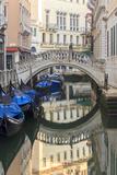 Gondola Parking under Bridge. Venice. Italy Photographic Print by Tom Norring