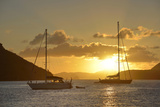 British Virgin Islands, Tortola. Caribbean Sunset with Sailboats at Soper's Hole, West End Photographic Print by Kevin Oke