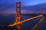 Golden Gate Bridge Sunset Pink Skies Evening with Lights of San Francisco, California in Background Photographic Print by William Perry