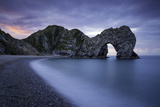 Colorful Sky at Dawn over Durdle Door Along the Jurassic Coast, Dorset, England Photographic Print by Brian Jannsen