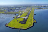 Main Runway at Auckland Airport, and Manukau Harbour, Auckland, North Island, New Zealand Photographic Print by David Wall