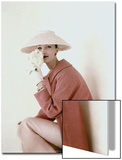Vogue - March 1956 - Model Evelyn Tripp wearing pink ensemble Wall Art by Karen Radkai
