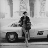 Vogue - September 1955 - By the Arc de Triomphe Metal Print by Henry Clarke