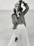 Vogue - April 1972 - Woman with a Film Camera Metal Print by Gianni Penati