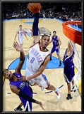 Sacramento Kings v Oklahoma City Thunder: Russell Westbrook and Donte Greene Posters by Larry W. Smith