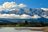 A Landscape Image of White Clouds Surrounding in the Canadian Rocky Mountains Photographic Print by Robert McGouey