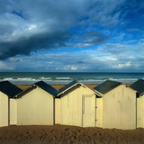 Beach Huts under a Stormy Sky in Normandy. France Photographic Print by Bernard Jaubert