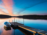 Boat Near Pier over a Idyllic Lake Photographic Print by Mikael Svensson