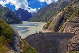 Great View from the Top of the Grimsel Pass over the Grimselsee Dam Photographic Print by ivan kmit