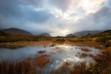 Dramatic Light Reflected in a Small Lochan at Sligachan, Isle of Skye Scotland UK Photographic Print by Tracey Whitefoot
