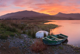 The Sun Rises Behind Mount Snowdon Creating a Beautiful Orange Sky Photographic Print by John Greenwood