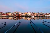 Colourful Houses Reflected in a Still Harbour Photographic Print by Mikael Svensson