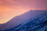 Afterglow Lends Color to a Snowy Mountainside Photographic Print by Robbie George