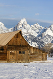 The Architecture of a Log Cabin Mimics the Structure of the Mountains Behind It Photographic Print by Robbie George