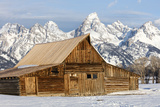 A Log Cabin Sits before the Mass of the Teton Range Photographic Print by Robbie George