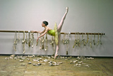 A Ballerina Poses with All the Pointe Shoes She Used in Her Career Photographic Print by Kike Calvo
