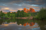 A Summer Storm at Sunset Frames Sedona's Iconic Cathedral Rock Reflected in Oak Creek Photographic Print by Derek Von Briesen