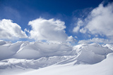 Pristine Snow Drifts Meet Large Puffy Clouds Photographic Print by Robbie George
